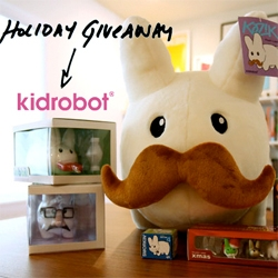 "NOTCOT Holiday Giveaway #4: Kidrobot is giving away a HUGE bundle of Labbit goodies! From a 24"" stuffed mustached one to a bunch of toys as well!"
