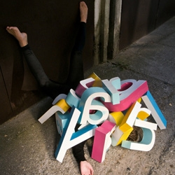 Hungarian artist Lajos Major plays with the alphabet in the perfect mix of typography and photography.