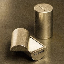 Adorable Le Labo solid perfumes in a little metal capsule (though it doesn't say the exact size...)