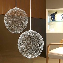 Designed by German artist Steffen Bauer for Crescent lighting, the Laluna fiber optic lamp connects to a bright halogen (which changes color with a turning color wheel) or color-changing LED light source.