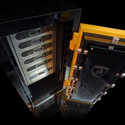This is a one-of-a-kind Lamborghini safe crafted as a unique offering to match the real-life automobile of a client of Brown Safe. It features yellow plating, carbon fiber trimming and the raging-bull logo appearing throughout.