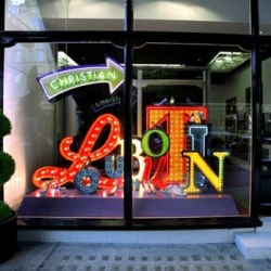 Designers Studio XAG have created a window installation in London (Mount Street) for French fashion designer Christian Louboutin, spelling out the brand name in bright neon lettering.