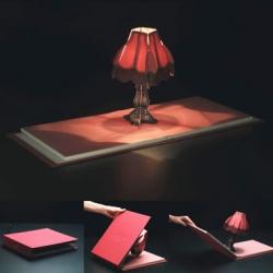 Artecnica's ultimate illuminated manuscript, Book of Lights' pop up protagonist emits a tabletop warming glow.