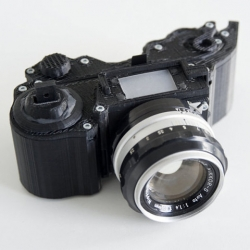 The OpenReflex is an Open-Source 3D printed analog camera with a finger activated mechanic shutter, and compatible with any photographic lens thanks to a custom mount ring. Created and designed by french artist Léo Marius.