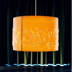 Cathrine Krullberg's Norwegian Lighting series uses lasercut wood designs through which light eminates. Via Mocoloco
