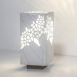 This Japanese-style organic Voronoi cellular structure light is Made of laser cut Plywood by Mariam Ayvazyan.