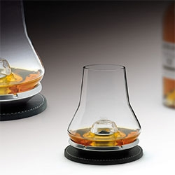 Whisky Tasting Set by Nicolas Brouillac. This originally-shaped glass is the latest addition to Les Impitoyables wine-tasting collection  The clever metal cooling base offers the ideal temperature without any need for ice.