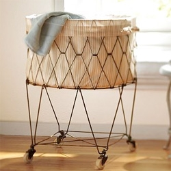 "French Wire Hamper - ""Poised on swiveling casters, our wirework hamper ferries loads of laundry to the washer or rounds up stray toys and shoes."""