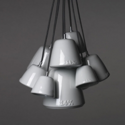 Laura Strasser's 14% hanging lamp is almost art. Each porcelain lampshade is a cast of the previous, larger shade and is itself the model for the next, smaller one.