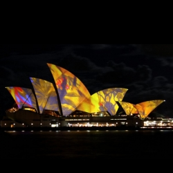 Laurie Anderson's Lighting the Sails projects gorgeous colors and patterns onto the Sydney Opera House. Lighting the Sails remains on view at the Sydney Opera House through June 20th.