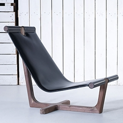 Hookl Und Stool Armada High Armchair is a beautifully minimalist leather and wood piece.