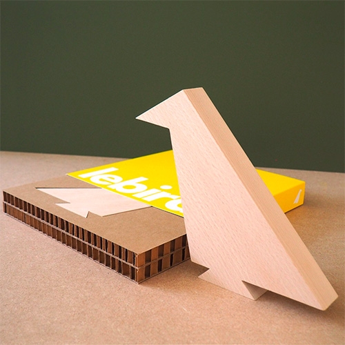 lebird - love the simplicity of the packaging with the wooden bird set into corrugated cardboard, tucked into a bright yellow sleeve.