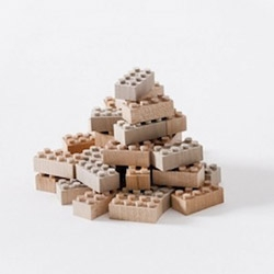 "Japanese designers at Mokurukku have created a set of beautiful ""knock-off"" LEGO bricks that are made from maple and birch. Carefully crafted to be stackable with regular plastic LEGO bricks."
