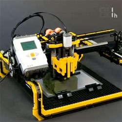 A 3D milling machine composed of Lego and a metal drill bit by Arthur Sacek.