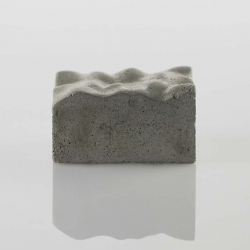 Concrete Paperweight is a minimalist design created by Rhode Island-based designer Kebei Li.