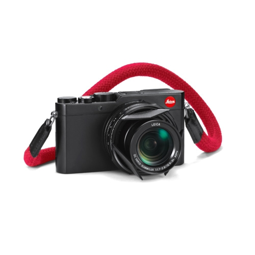 "The Leica D-Lux Explorer Kit. Interesting new features: Automatic lens cap flaps and the red ""robust hardwearing cotton"" carrying strap."