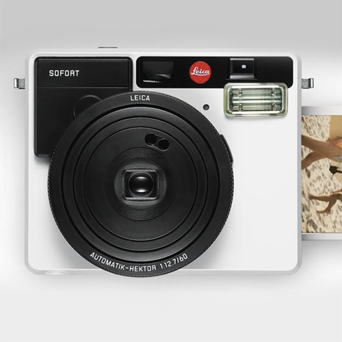 Leica Sofort - the first instant camera from Leica. Available in orange, mint, and white.