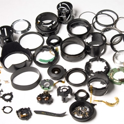 Incredible forum thread of images of disassembled Canon lenses