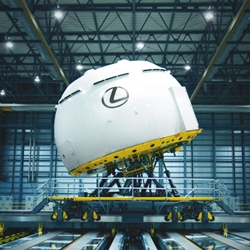 Lexus unveiled what it claims to be the world's most advanced driving simulator . It is 15-feet tall and 56-feet in diameter and sits on a three axis hexa-pod system.