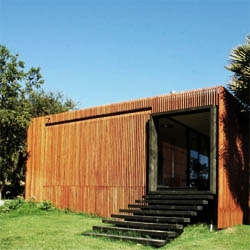 A small spa at Las Palmas in Leyda, Chile.  It has a wood skin that allows it to integrate with its surroundings while maintaining certain privacy. By Land Arquitectos.