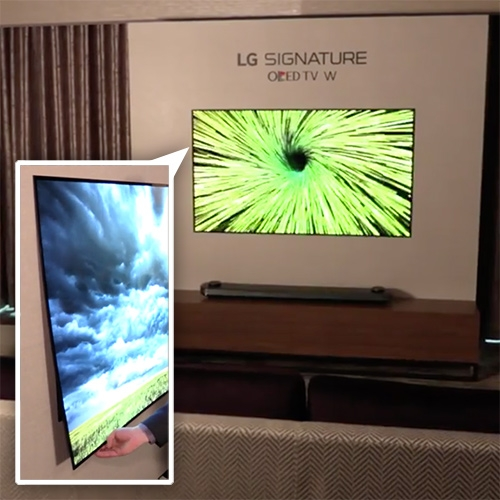 LG W-Series OLED is a mere 1/10 of an inch thick! And is held on with keyholes at the top and magnets at the bottom. It hangs more like wallpaper than a frame. Digital Trends has a nice hands on look with it at CES.