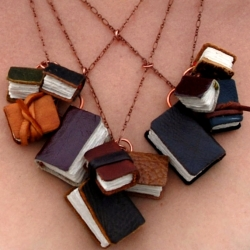 A usable and wearable miniature library by the Black Spot Books.