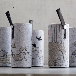 Libratone just released the limited Fairytale Edition. Five scenes from Thumbelina by H. C. Andersen are embroidered on the wool sleeves of Libratone Zipps. All hand-made by cartoonist Stine Spedsbjerg.