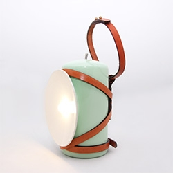 'Lena' inspired by the old miner's lamp, is a small cordless torch light, equipped with a rechargeable battery.