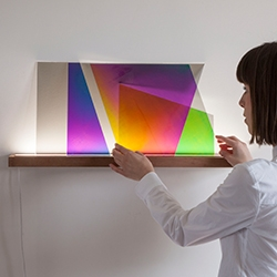 101.86° by Thomas Vailly and Laura Lynn Jansen. A magical light that changes colors as you layer and rotate various pieces.
