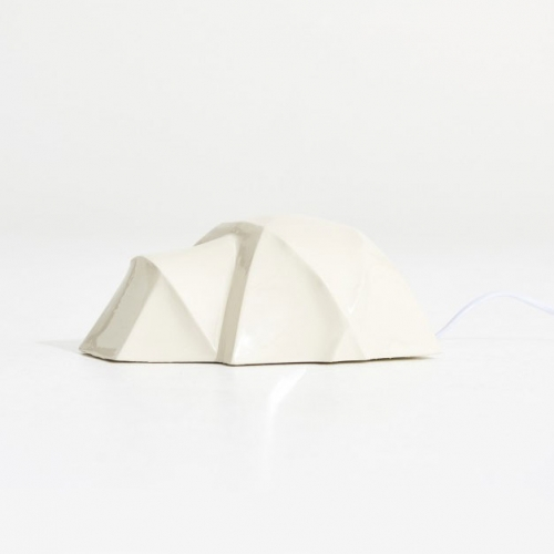 Noddy Boffin porcelain Tent Lamp. Inspired by camping tents glowing at night, the 'Tent Lamp' brings the outdoors indoors in a playful, almost nostalgic way.