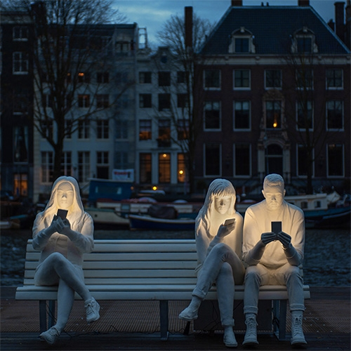 Absorbed By Light sculpture by Design Bridge's Gali May Lucas for the 2018 Amsterdam Light Festival. Perfectly highlighting our screen obsessions, while becoming the perfect instagram photo spot too...