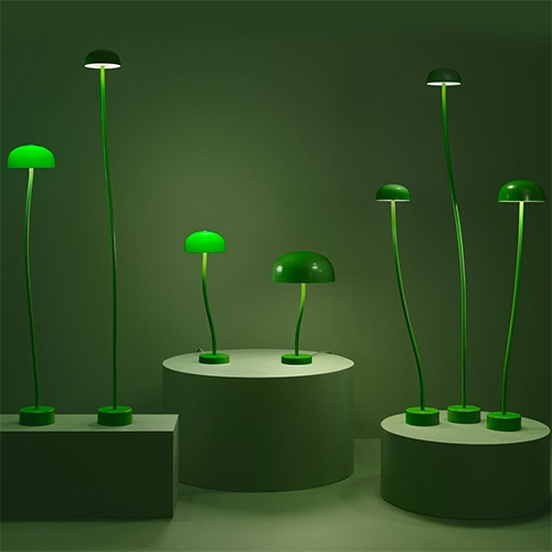 Front Design Curve lights for Zero. From the small but heavy base springs the lamp like a sprouting plant or mushroom. The collection now contains pendants, floor and table lamps in green or white glass or with metal shades  in blue, ivory, white or green.