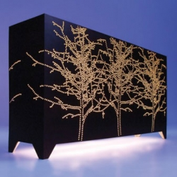 Lightbox is actually a wood cabinet with 8000 holes reinforced with transparant resin. Designed by Studio Jo Meesters.