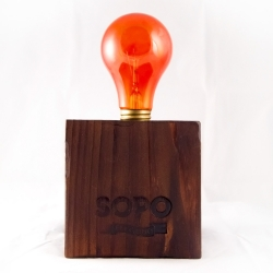 Bulbs on bases of salvaged Eastern White Pine with details of its origin. SoPo Electric is selling remnants of the Lower Manhattan blackout, and proceeds going back to local businesses.