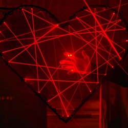 GNI-project's 'LIGHT ♥ FRANKFURT' installation consists of a stylized heart rendered by criss-crossing red laser beams.