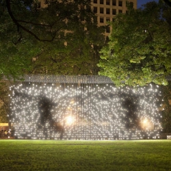 "Jim Campbell's  ""Scattered Light"" installation turns Madison Square Park into an amplified version of a Lite-Brite, illustrating figures running through the park- Magical!"