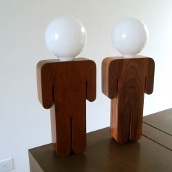 lightboy is a man icon table lamp, made out of either solid wood of layered plywood