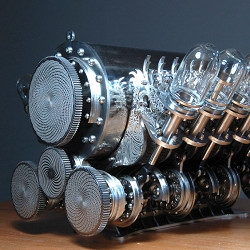 Limee Young makes amazingly complex kinetic sculptures using stainless steel components, embedded cpu boards, microprocessors, servos, and other mechanical bits.
