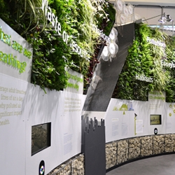 This 16ft tall curved living wall by Cod Steaks creates the center piece for Siemens  Sustainable Cities Initiative 'The Crystal' in London