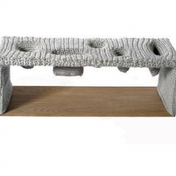 "Loyal Loot's ""Hung Table"" has a crocheted surface that ""takes away the need for vessels to hold possessions""."