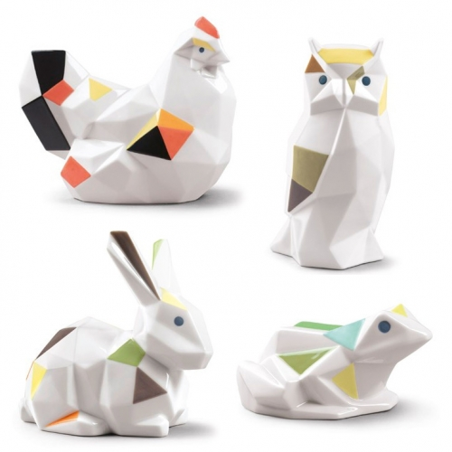 Lladró Origami Collection of faceted creatures sculpted by Marco Antonio Noguerón available in gloss with a dash of color and matte white. Rabbits, Owls, Swans, Frogs, and Chickens.