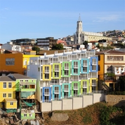 A series of colorful loft units in Valparaiso, an area declared World Heritage by the UNESCO. The new units were designed by ReArquitectura, with interior spaces full with natural light, green terraces and more.