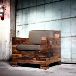 Handmade lounge chair made from barn siding and recycled military canvas from District Millworks, Los Angeles.