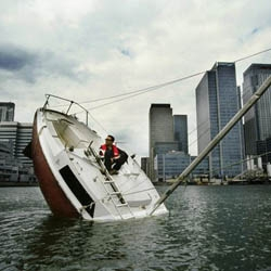 People try to rescue French artist Julien Berthier when he's out on his clever sculpture, Love Love, that looks like a sinking boat. It's actually a functional boat that was cut in half with a new keel & motor.