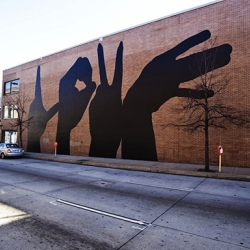Michael Owen develop a design of four hands spelling out the word LOVE for the project Baltimore Love Project.