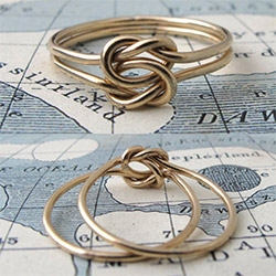 "Lover's Knot Ring ~ another lovely piece from Erica Weiner. ""It's made by interlocking two overhand knots in two parallel wires, so each one is flexible to move about the other, yet they're inseparable forever."""