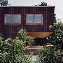 Swiss architects Luca Selva refurbished an old house, using a nice copper cladding that will age with the house, blending with the surrounding landscape.