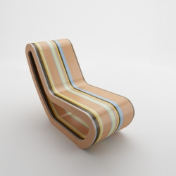 The Caramelo rocking chair is from Mexican designer Luis Luna.  Fun design, love the colors.