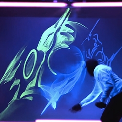 Luminous - spray artist, iNO live paints a UV light lit wall with glow spray paint! Amazing seeing the spray itself glow as he paints...