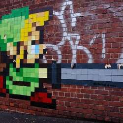 A Melbourne artist unleashes his (her?) inner graffiti geek on a brick wall. Coolio.